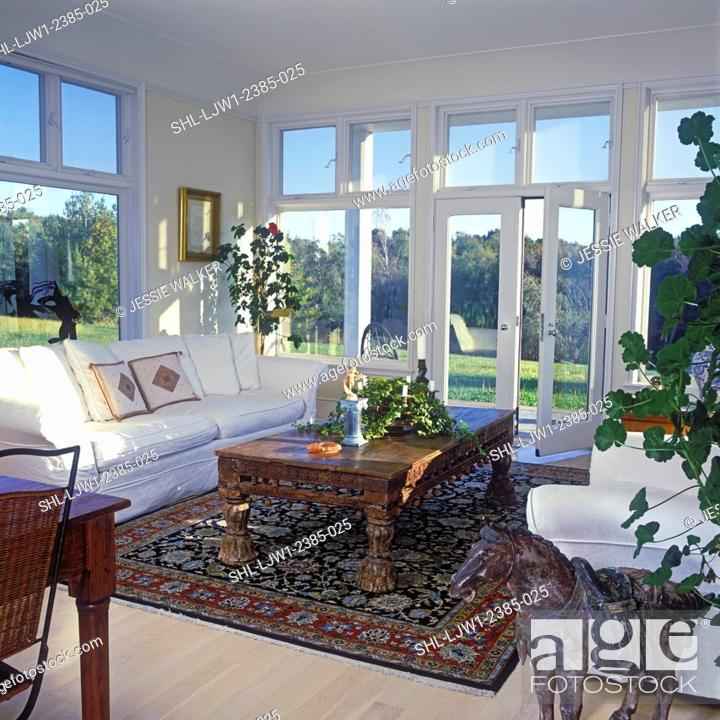 Stock Photo - LIVING ROOMS - International style mix of Oriental European American. White/cream rooms. French doors clerestory windows wood floor ... & LIVING ROOMS - International style mix of Oriental European ...
