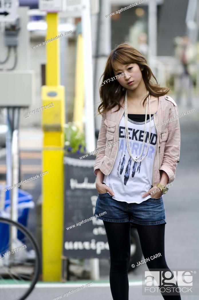 Stock Photo: Japanese Girl poses on the street in Jiyugaoka, Japan. Jiyugaoka is a town located in Tokyo.