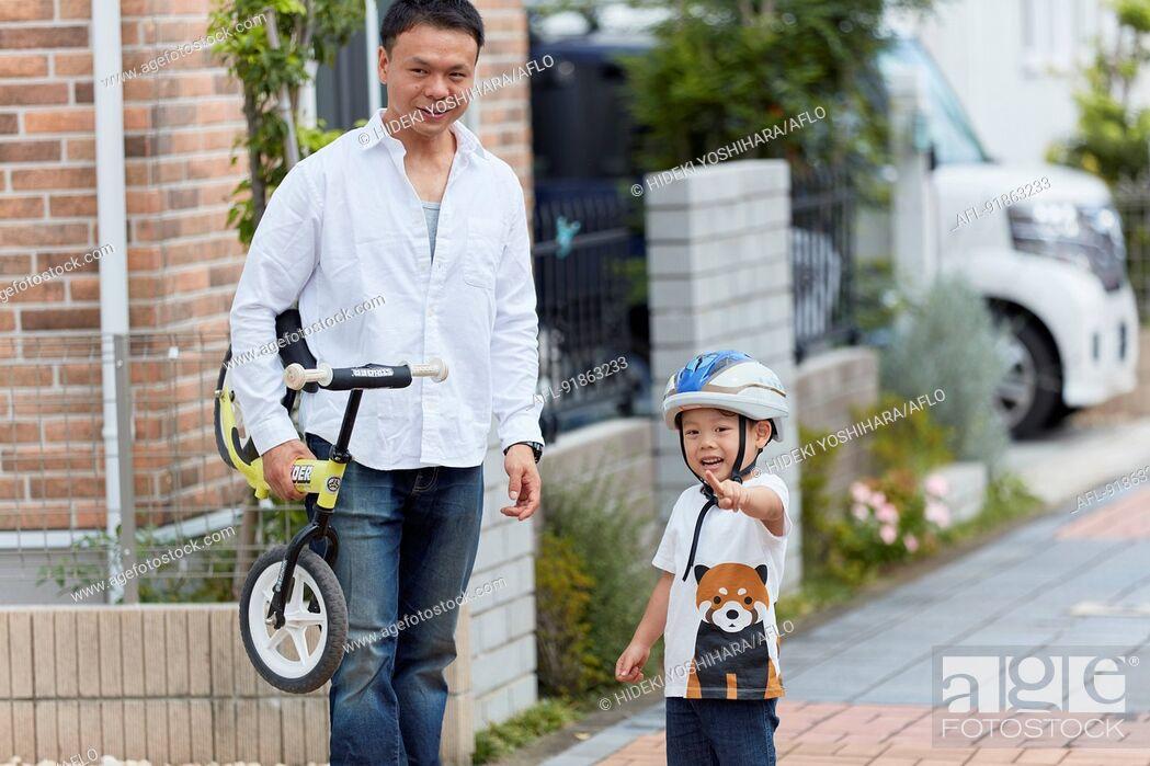 Stock Photo: Japanese family outdoors.