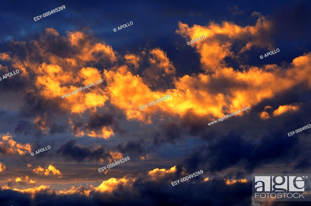 Stock Photo: Dramatically glowing clouds on the evening sky.