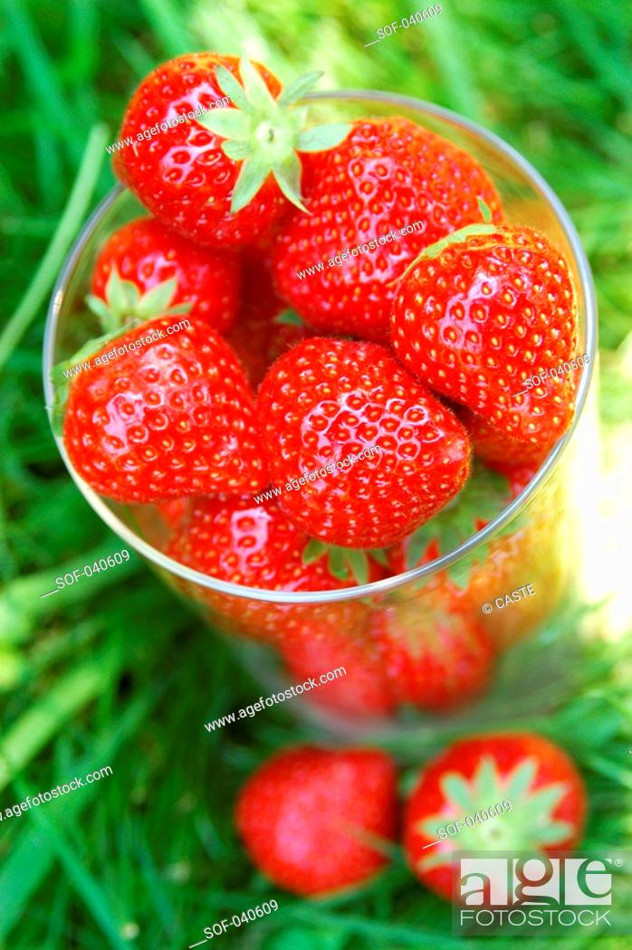 Stock Photo: strawberries in a glass.