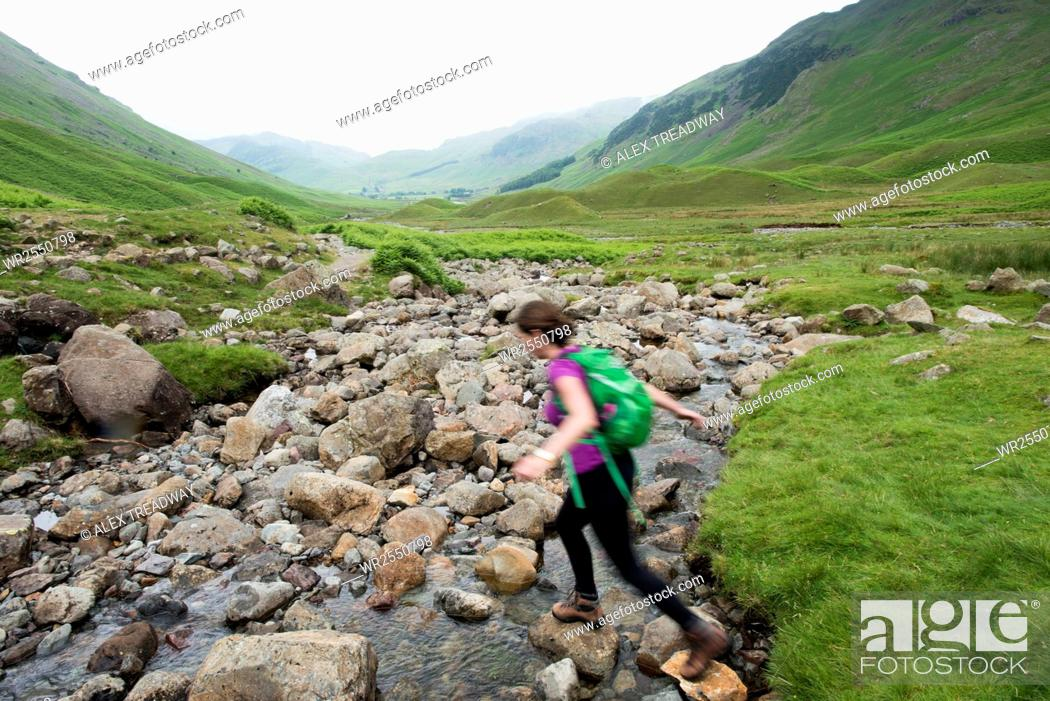 Stock Photo: Trekking along Mickeldon Valley in Great Langdale towards Bowfell in the Lake District National Park, Cumbria, England, United Kingdom, Europe.