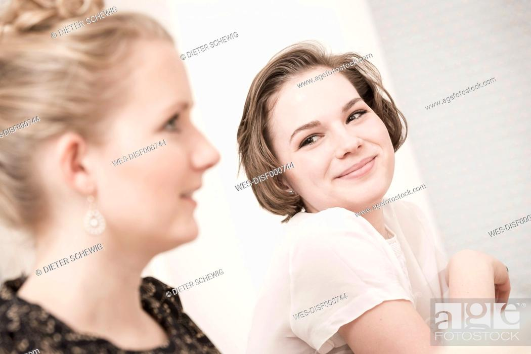 Photo de stock: Two young women on a retro style tea party.