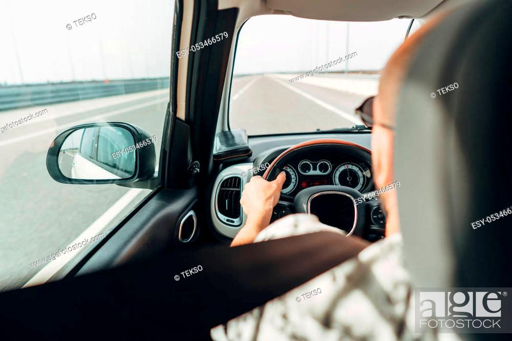 Stock Photo: The man behind the wheel of a car traveling on the road.