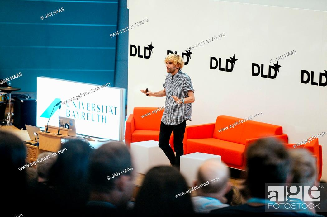 Stock Photo: BAYREUTH/GERMANY - JUNE 21: Cyborg Neil Harbisson (Cyborg Org) with his antenna gestures speaking on the stage during the DLD Campus event at the University of.