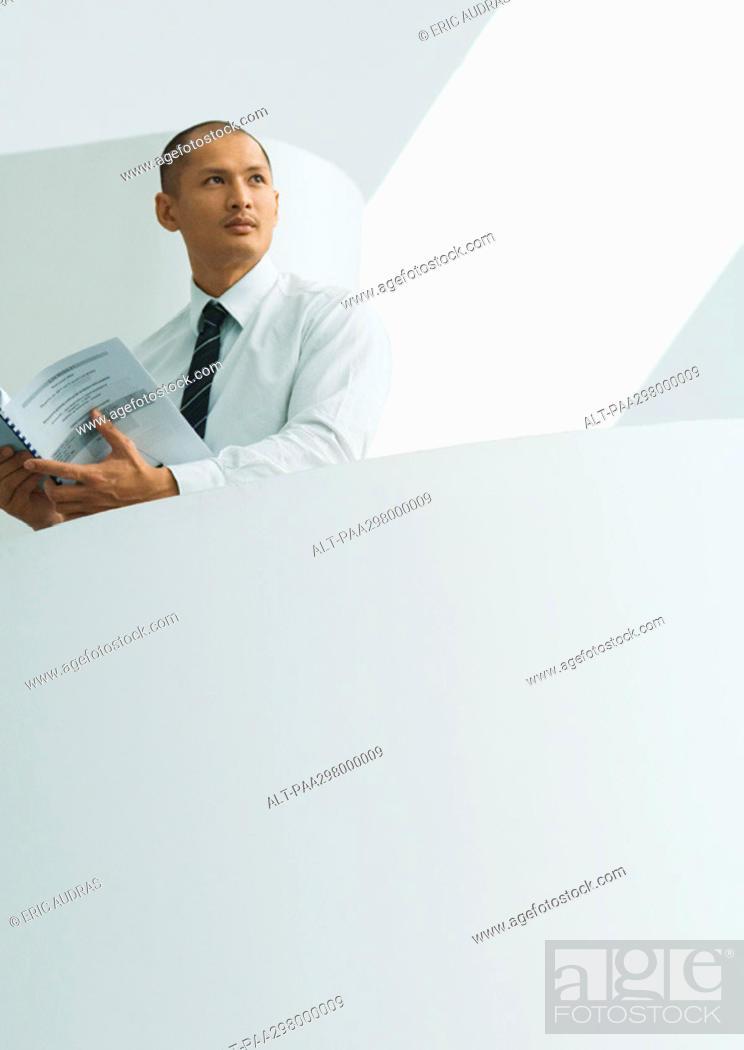 Stock Photo: Businessman holding document.