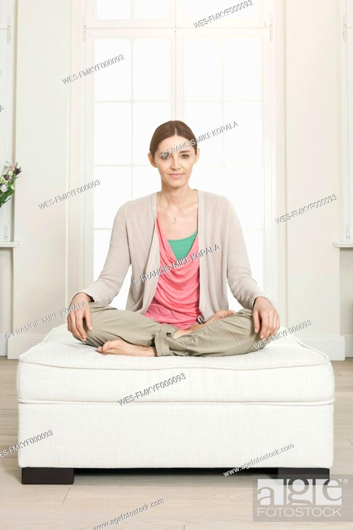 Stock Photo: Germany, Berlin, Mature woman sitting on seat, portrait.