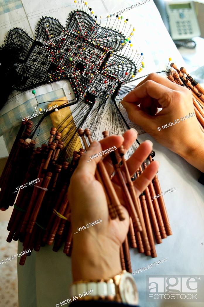 Stock Photo: Woman knitting bolillos. Spain.