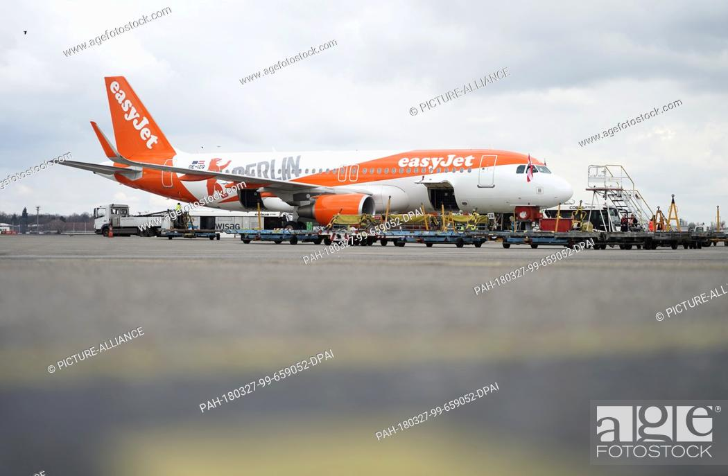 """Stock Photo: 27 March 2018, Germany, Berlin: An Easyjet Airbus A320-214 in """"""""Berlin colours"""""""" photographed in Berlin's Tegel Airport on the occasion of the presentation of."""