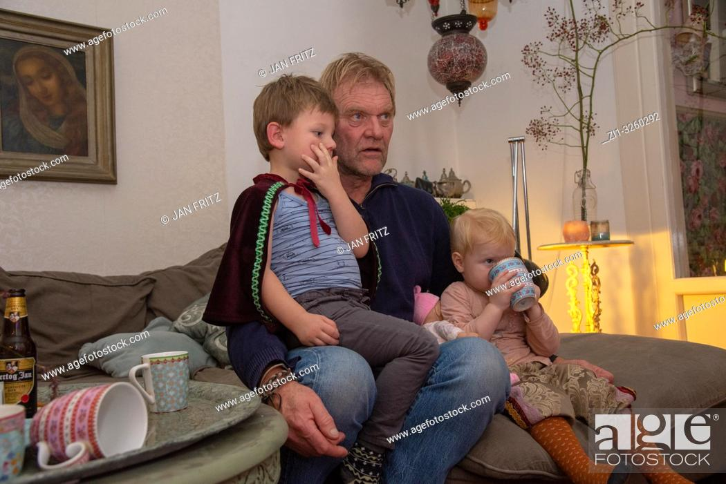 Stock Photo: grandfather with grandchildren watching tv.