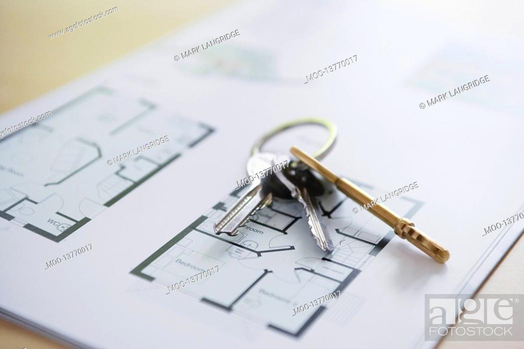 Stock Photo: Key ring with three keys lying on architectural blueprint close-up.