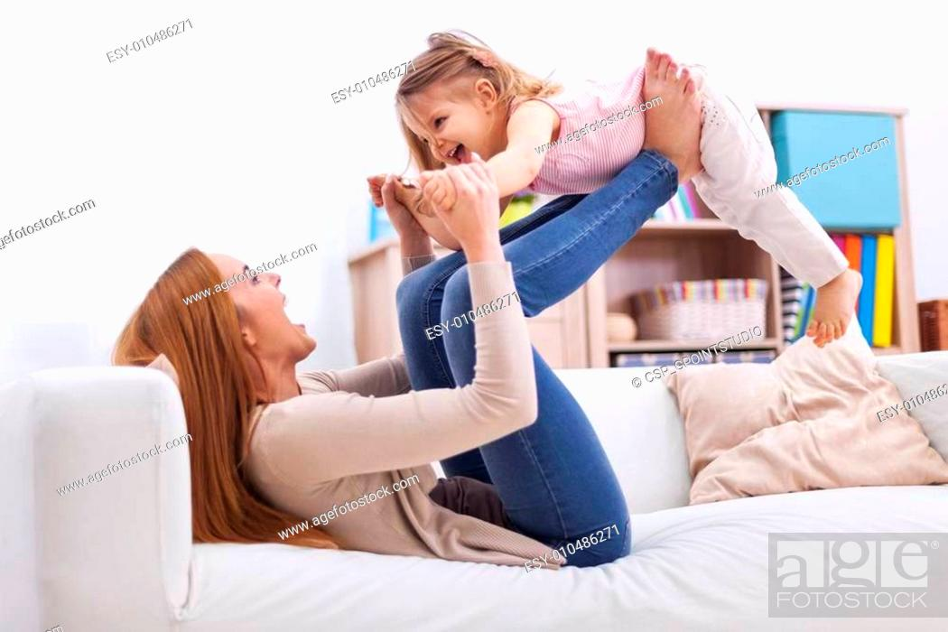 Stock Photo: Loving mother and daughter have fun together.