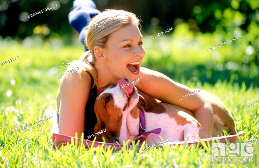 Stock Photo: girl playing with her dog.
