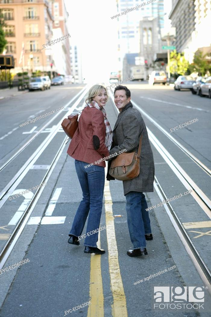 Stock Photo: Mature couple in the middle of the street.