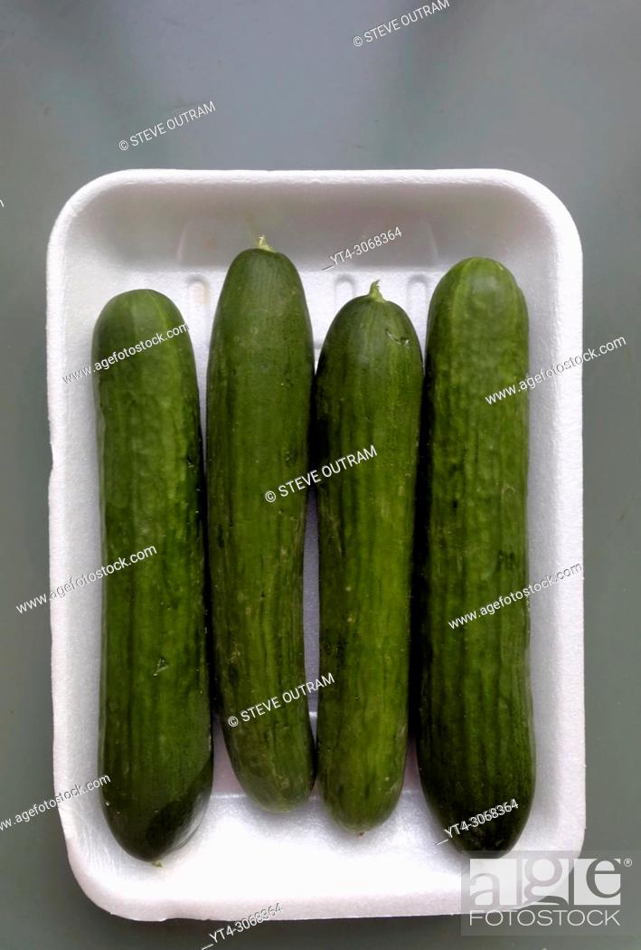 Stock Photo: Carton of Biologically grown Cucumbers from a local Greengrocers, Crete, Greece.