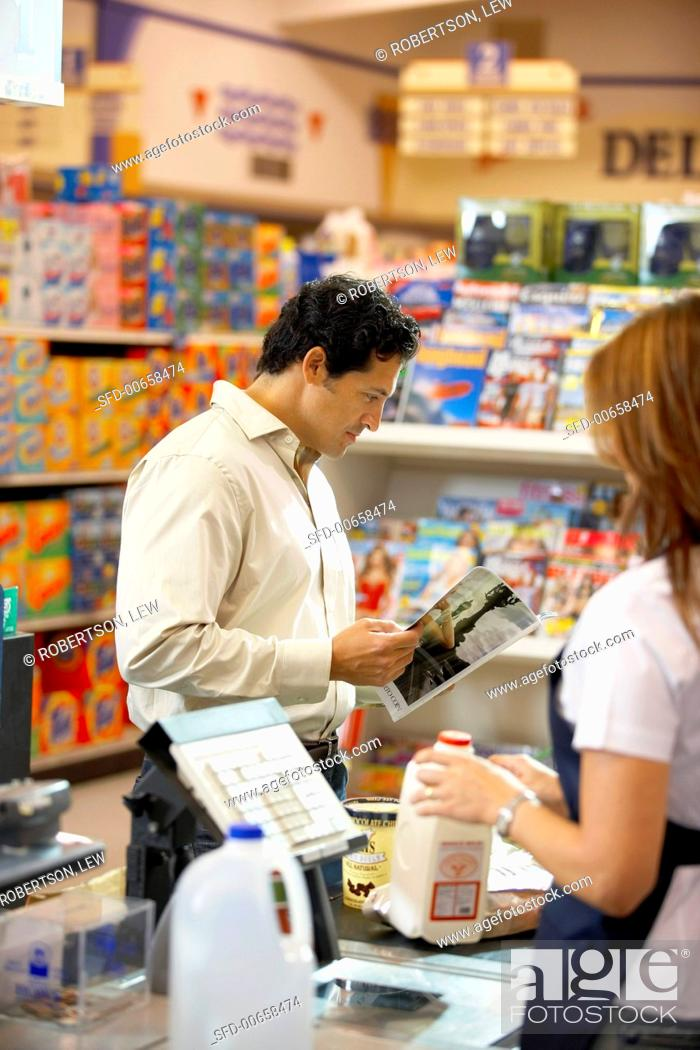 Stock Photo: Check-out girl serving customer in a supermarket (USA).
