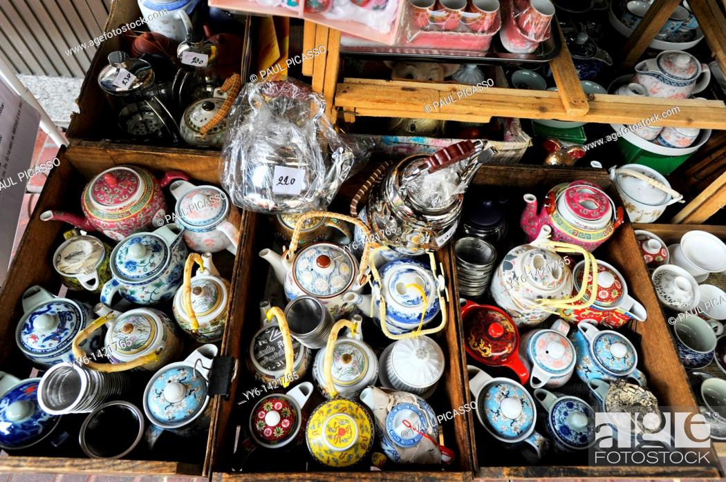 Stock Photo: Tea pots and china on display and for sale , Everyday living, street scene , chinatown , bangkok, Thailand.