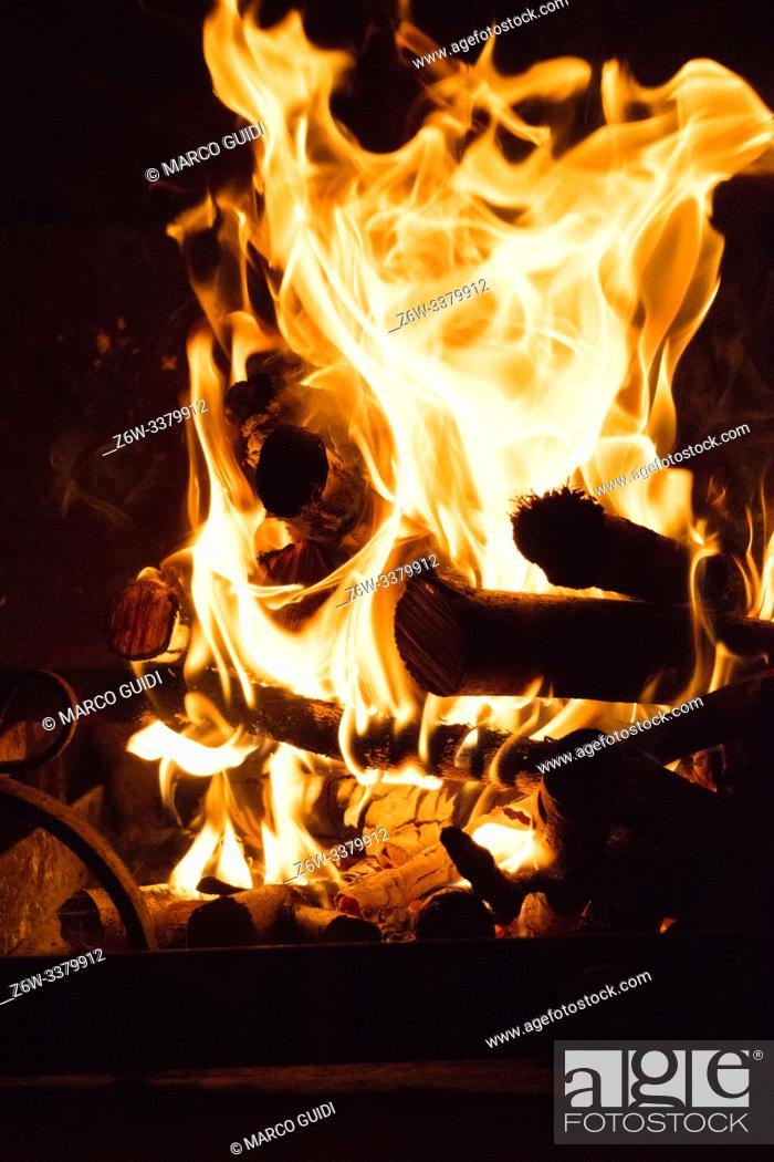 Stock Photo: Wood combustion for heat production for domestic heating.