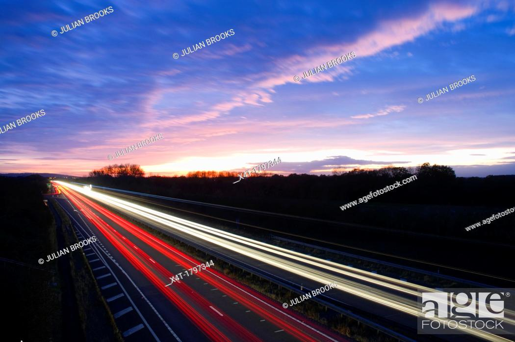 Stock Photo: The night sky with traffic, long exposure.