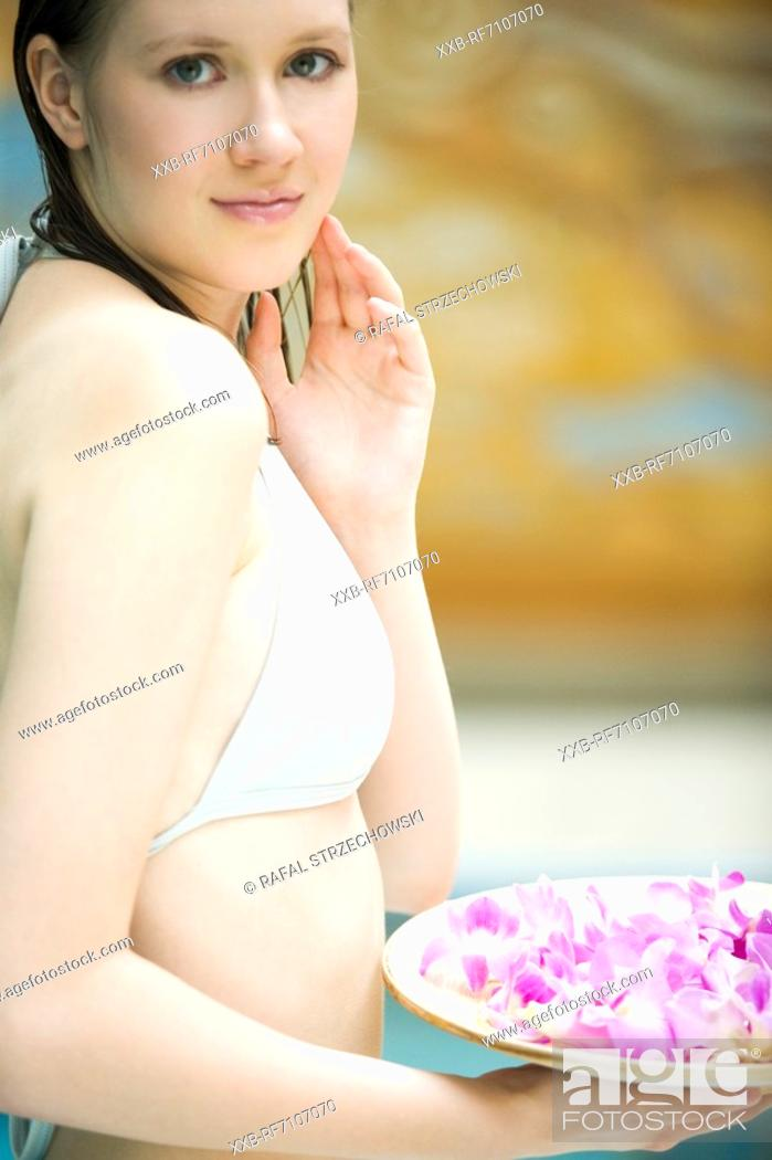 Stock Photo: Woman with flowers.