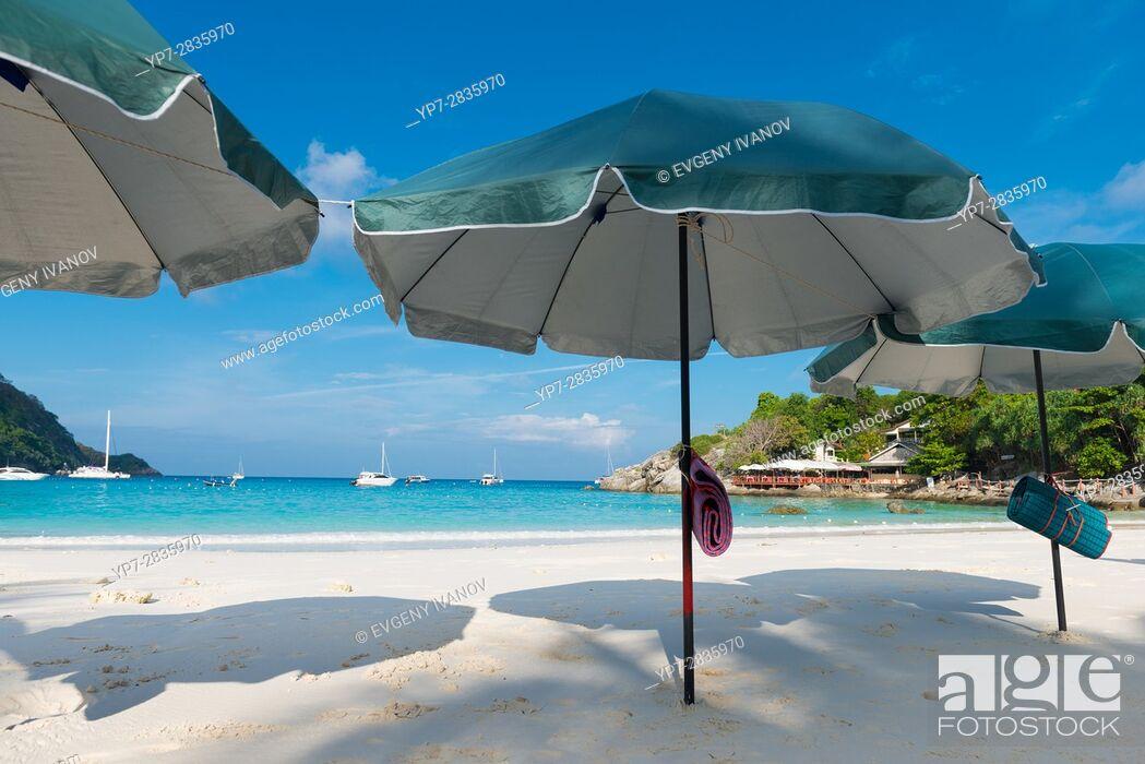 Stock Photo: Beach umbrellas waiting for tourists in Raya island, Thailand.