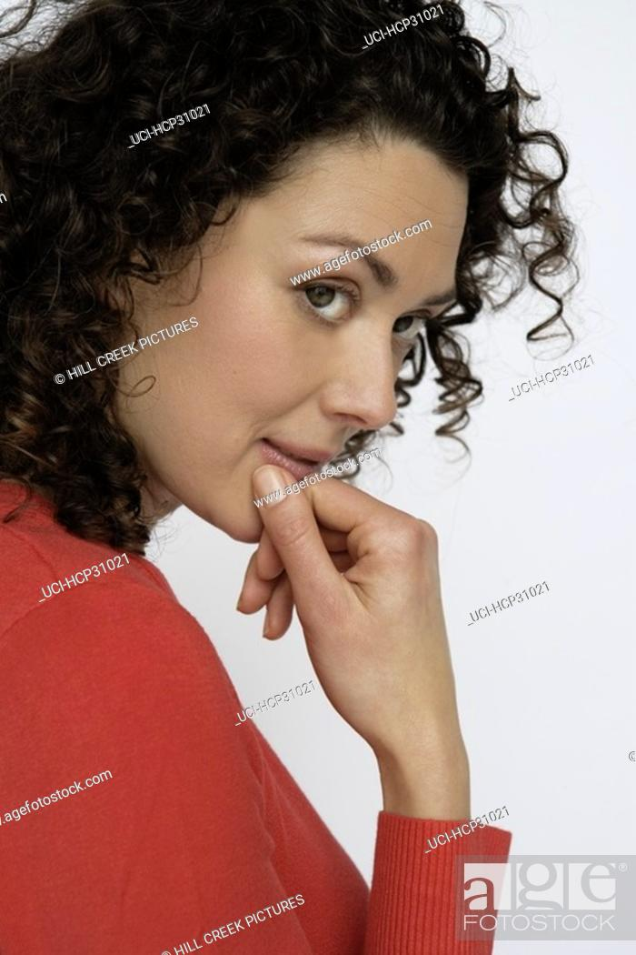 Stock Photo: Young woman thinking.
