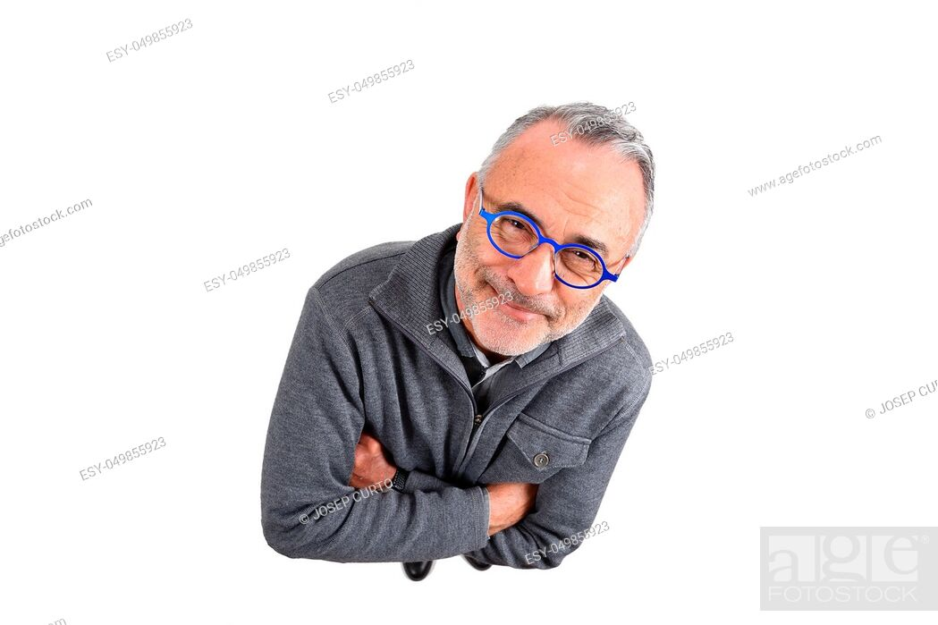 Stock Photo: man with arms crossed on white background.