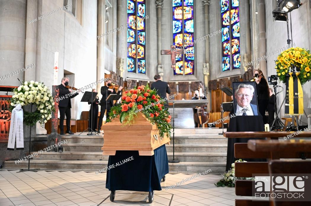 Stock Photo: 16 April 2021, Baden-Wuerttemberg, Tübingen: At the funeral service for the theologian Hans Küng, Hans Küng's coffin stands framed by floral decorations and.