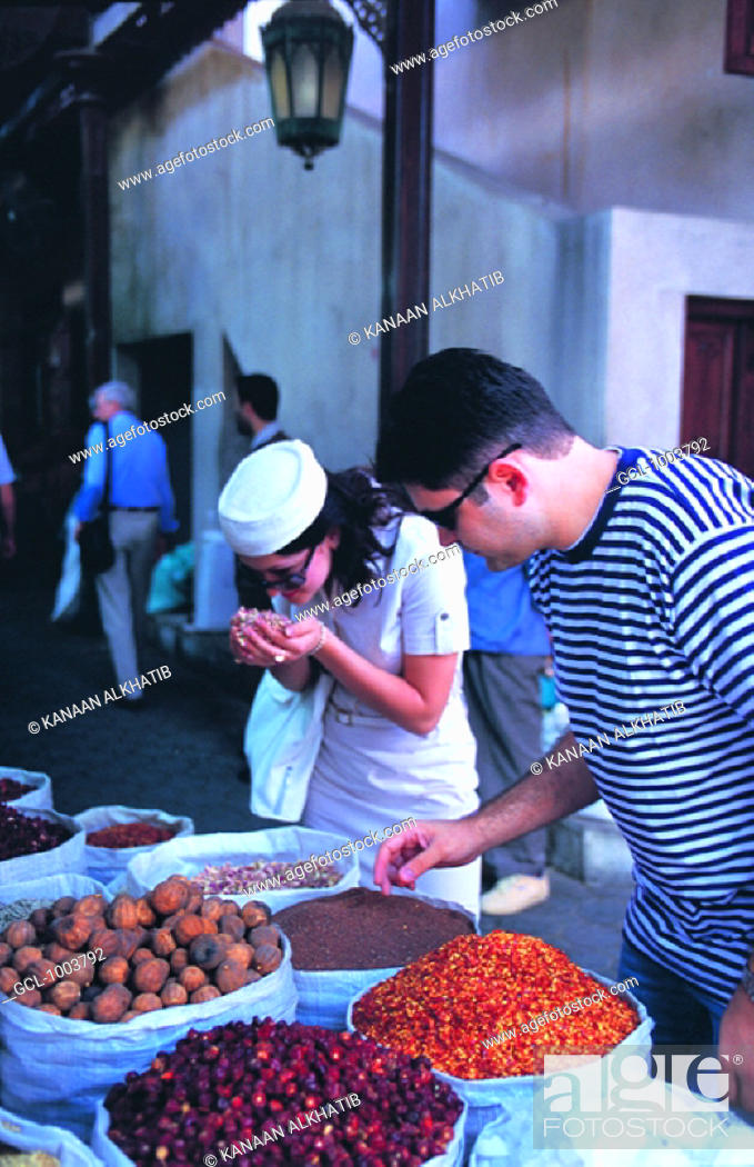 Stock Photo: Western tourists smelling exotic spices on the spice market in Dubai, United Arab Emirates.