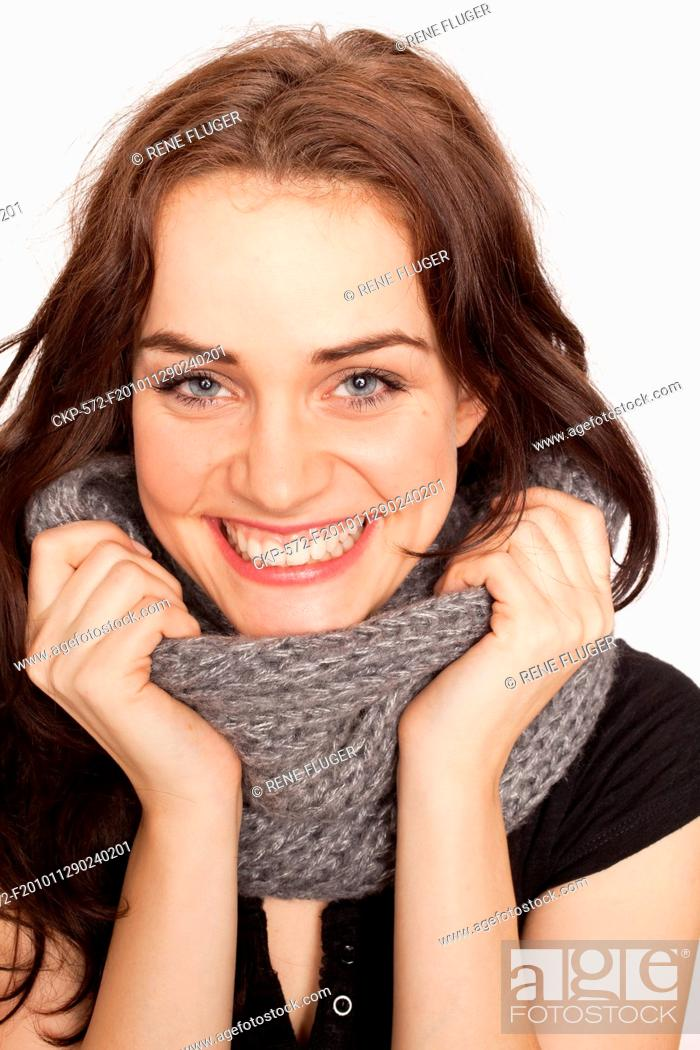 Imagen: A beautiful young woman, lady, girl, cold, runny nose, headache, scarf CTK Photo/Rene Fluger MODEL RELEASED, MR.
