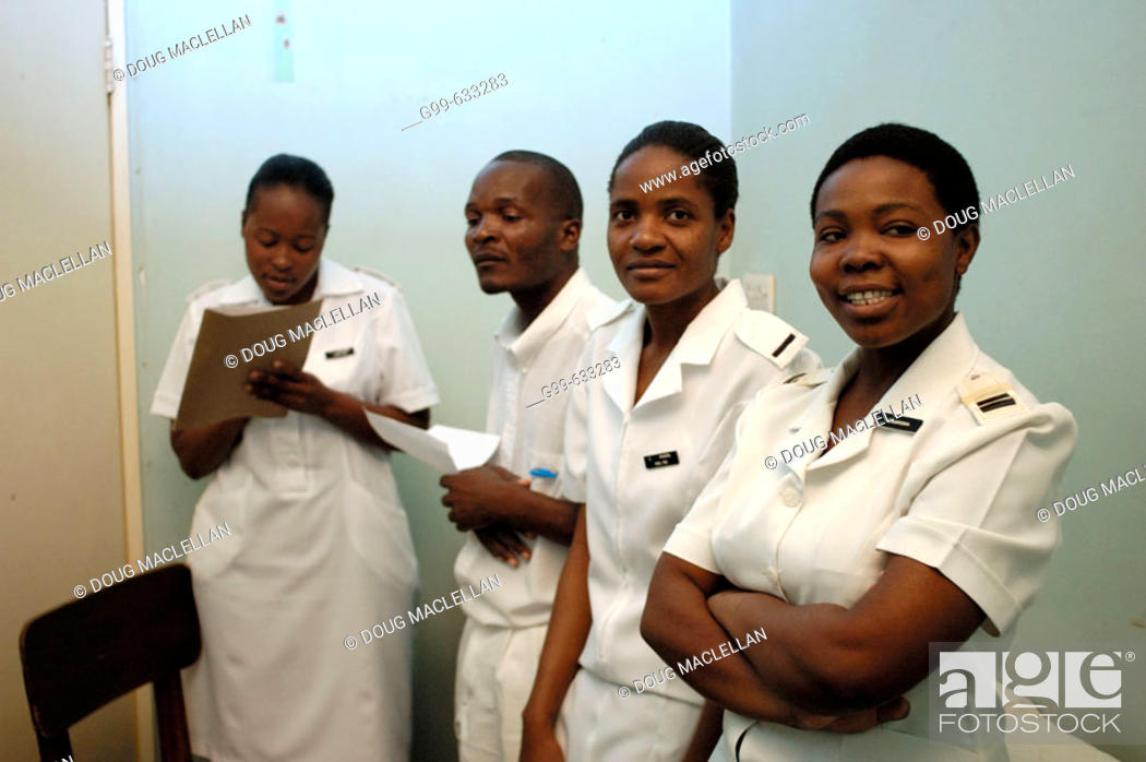 Stock Photo: Four nurses pose in an office at the Howard Hospital outpatient department. Some of the nurses attend the training centre.