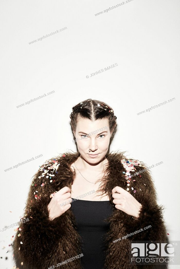 Stock Photo: Young woman with confetti.