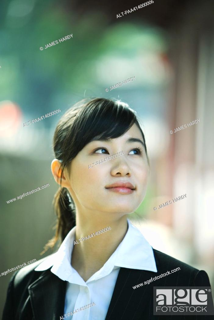 Stock Photo: Woman looking up, portrait.