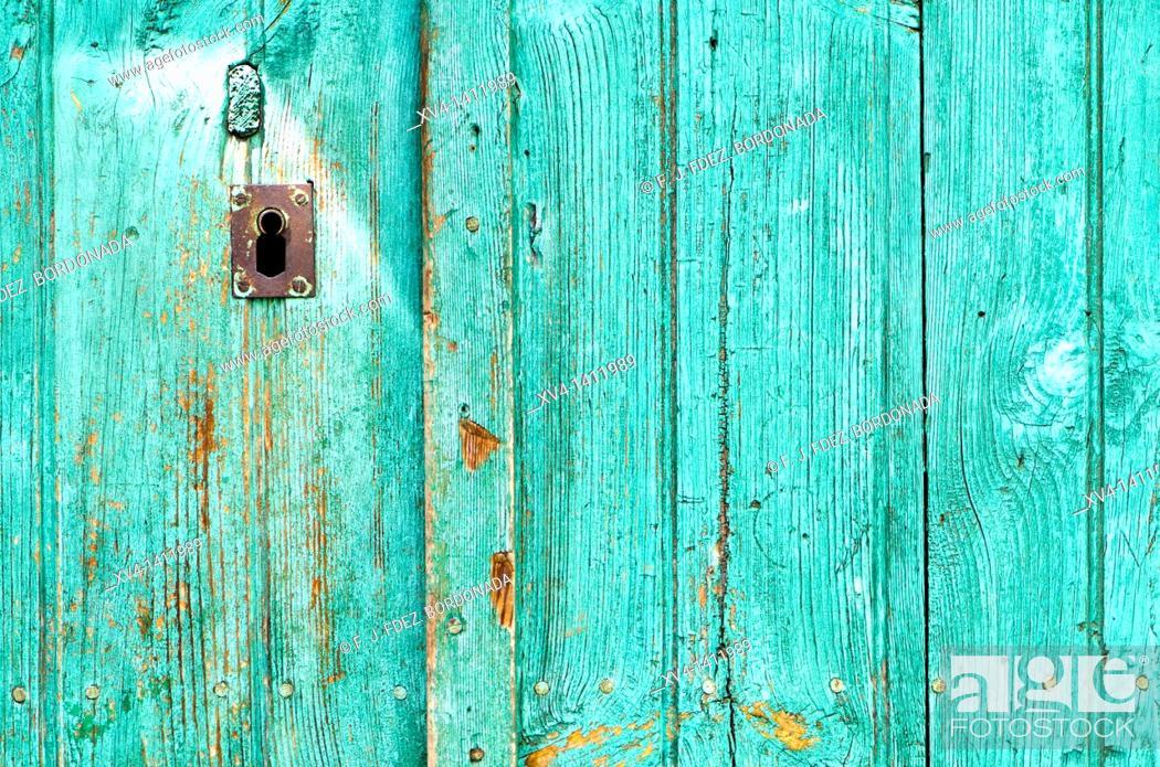 Stock Photo: Coloured door in Aragues del Puerto Village  Huesca Pyrenees  Aragon  Spain.