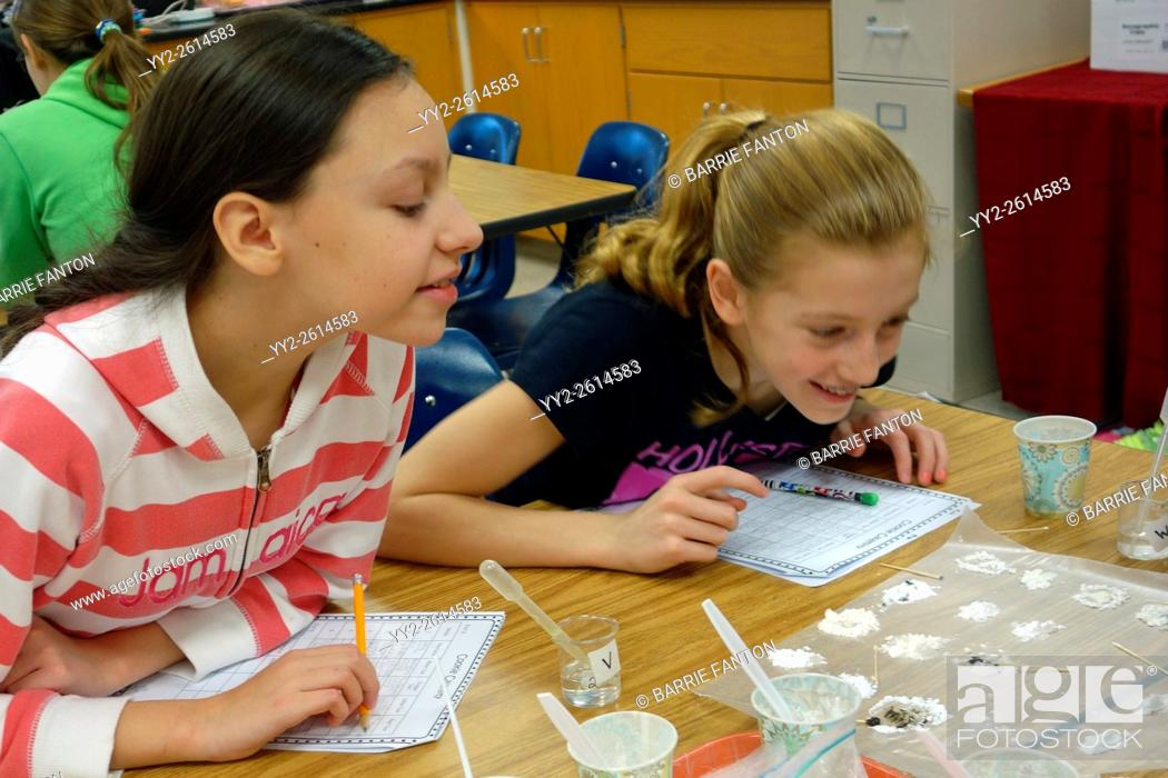 Stock Photo: Students Studying Chemical Reaction of Various Powders to Liquids, Wellsville, New York, United States.