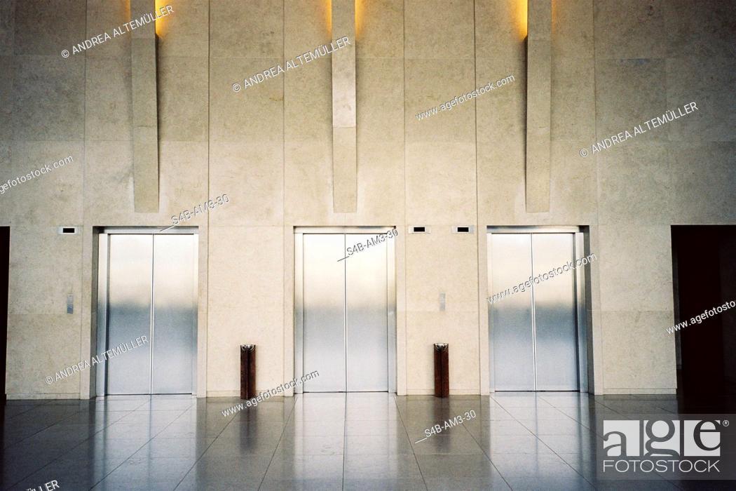 Stock Photo: Three elevators in hotel lobby, Sao Paulo, Brazil.