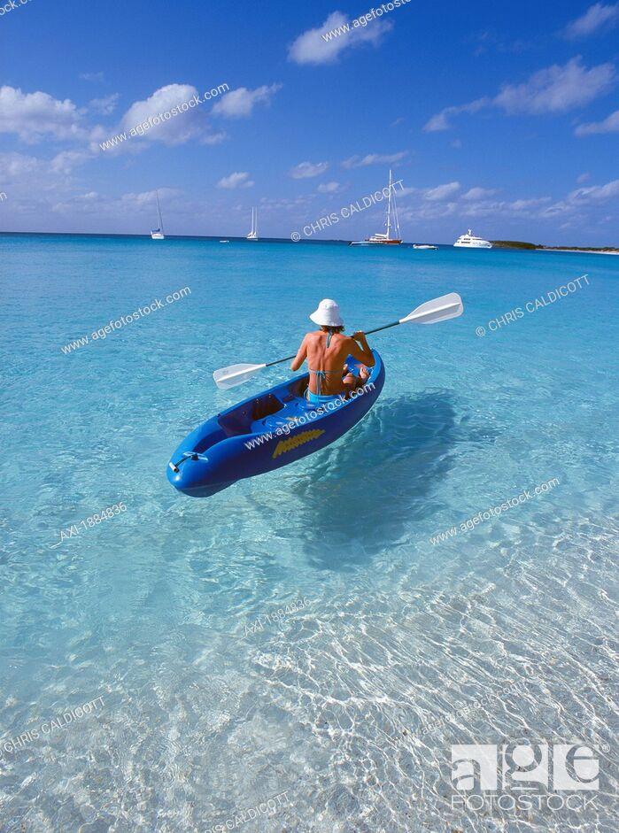 Imagen: Female Tourist In Kayak On Ocean.