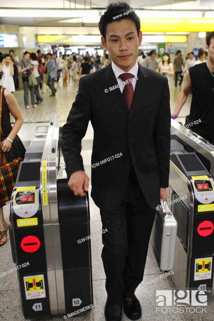 Stock Photo: Businessman at a railroad station.