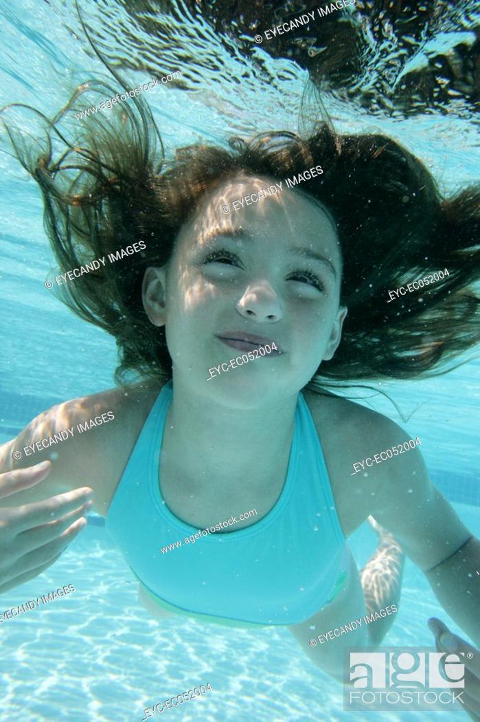 Stock Photo: Little girl swimming.
