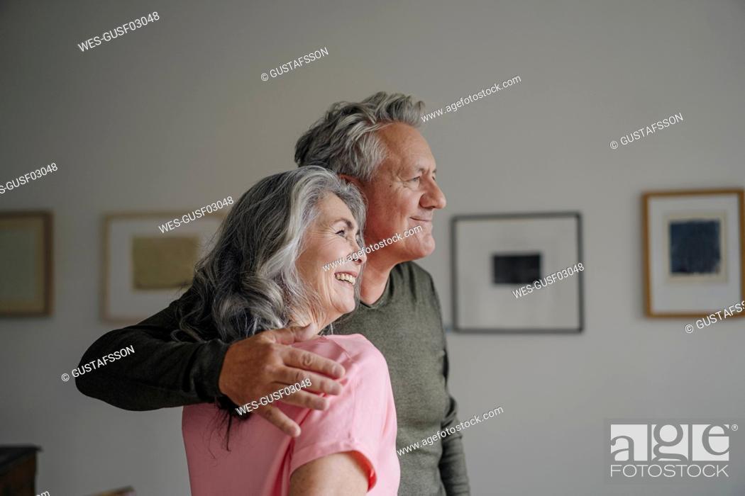 Stock Photo: Smiling senior couple at home.