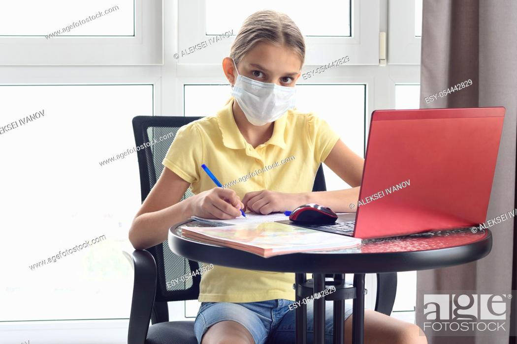 Stock Photo: A sick quarantined girl remotely learns and looked in frame.