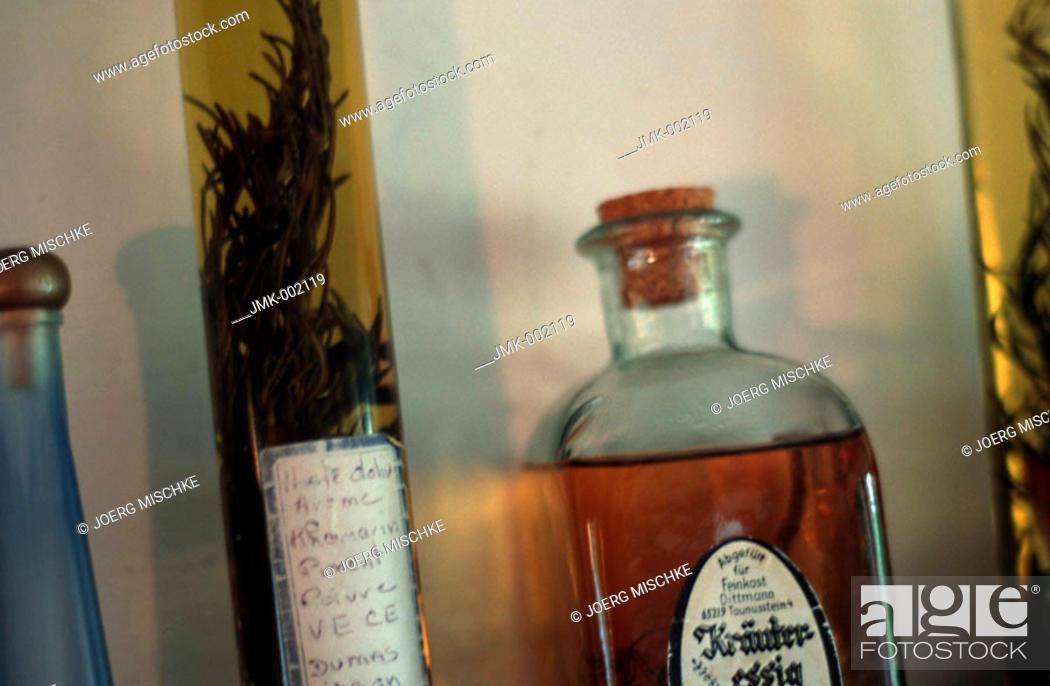 Stock Photo: Bottles, oil, vinegar, on a kitchen board.