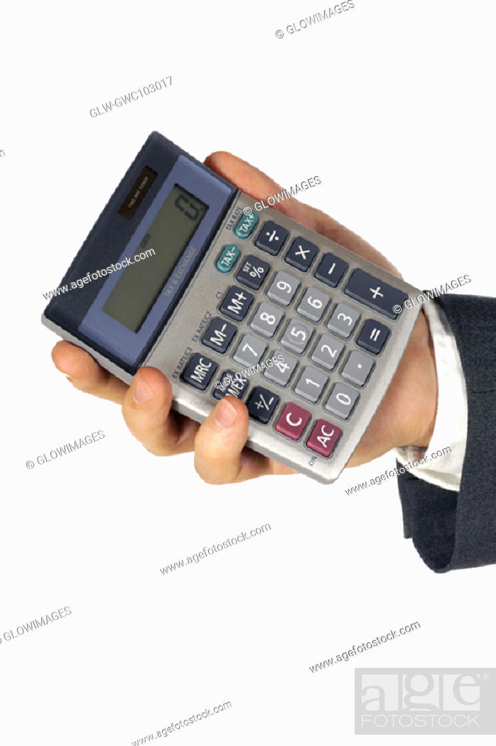 Stock Photo: Close-up of a businessman holding a calculator.