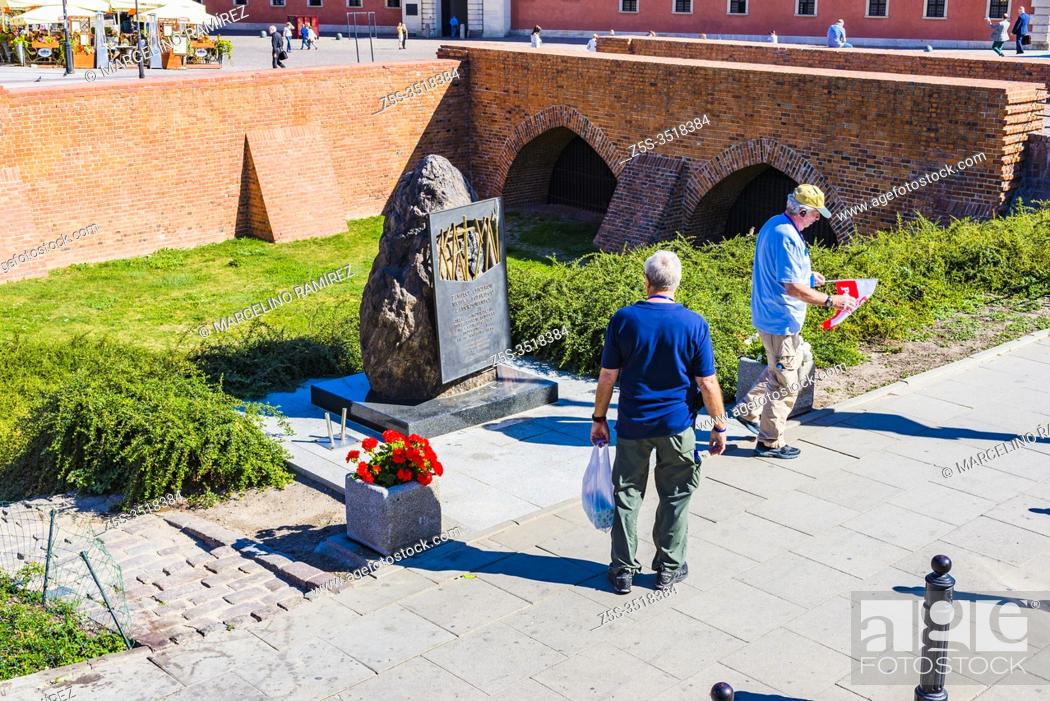 Stock Photo: Katyn monument in Warsaw, commemorating the victims of the Katyn massacre designed by the sculptor Andrzej Renes, in the background historical houses in the.