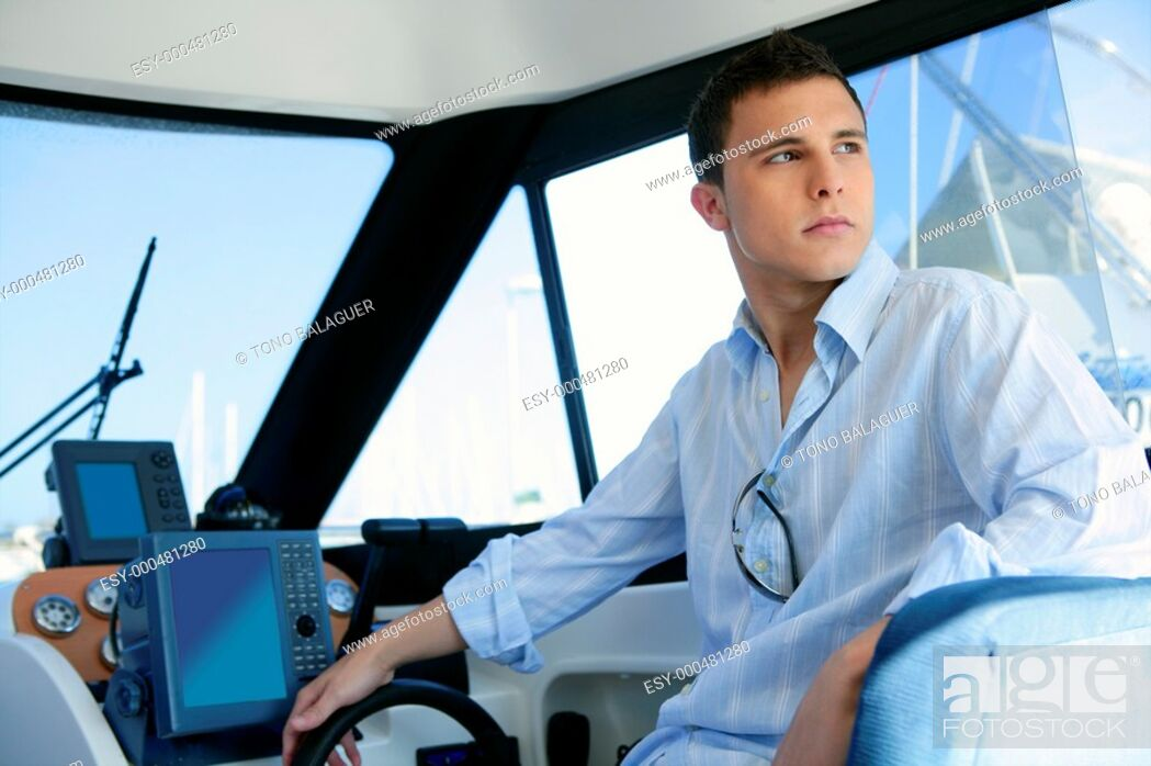 Imagen: Young handsome man on a yacht boat interior in summer.