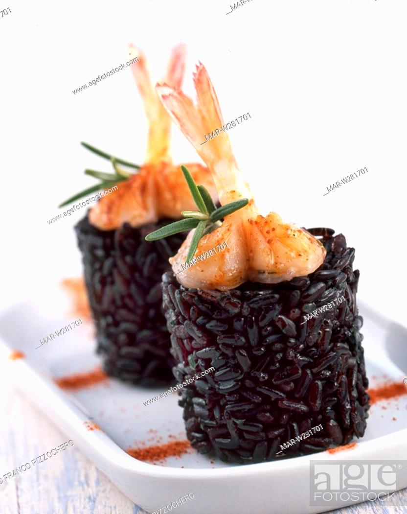 Stock Photo: timbale with venere rice and crayfishes.