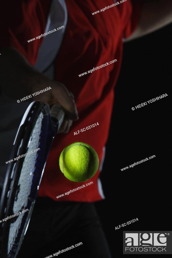 Stock Photo: Tennis Player Swinging at Ball.