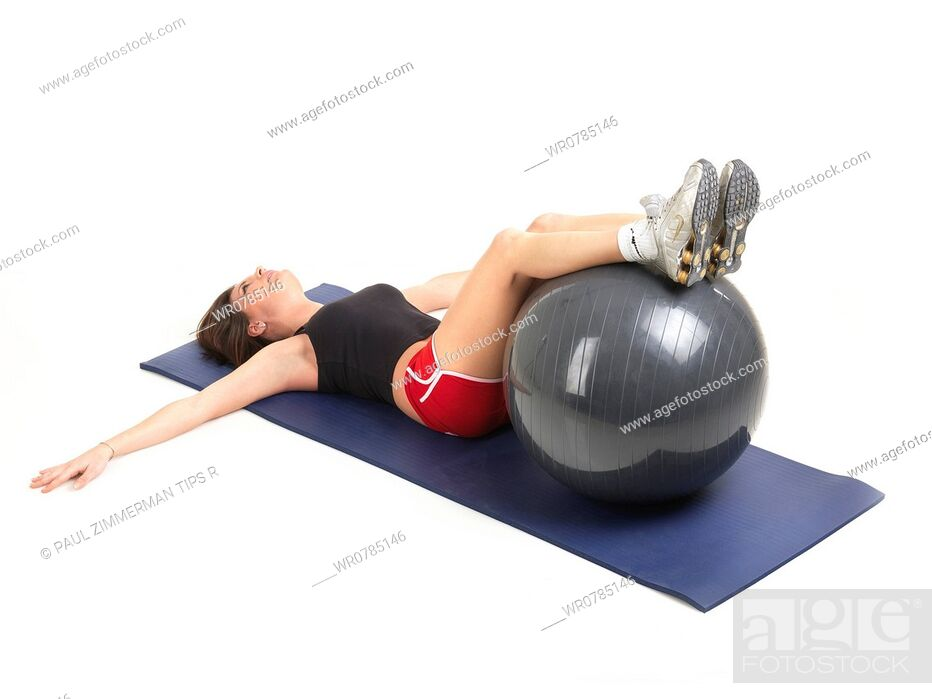Imagen: Woman exercising with fitness ball, studio shot.