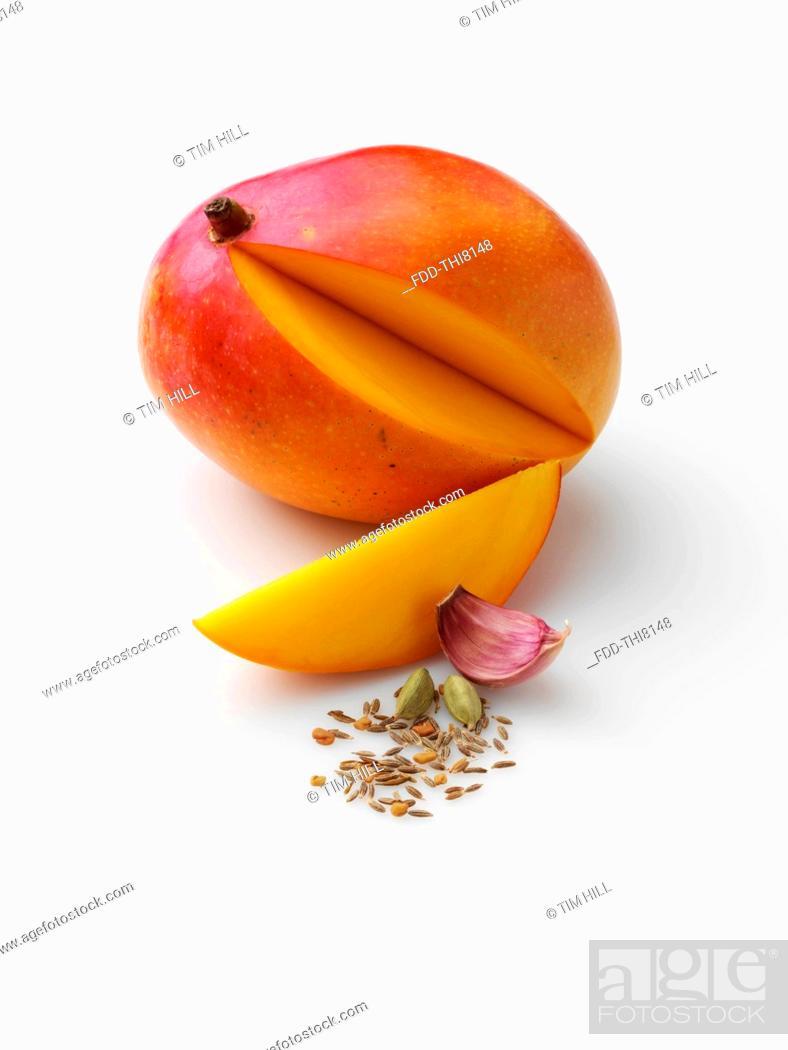Stock Photo: Honey mango with garlic cardomon fennel fenugreek cumin.