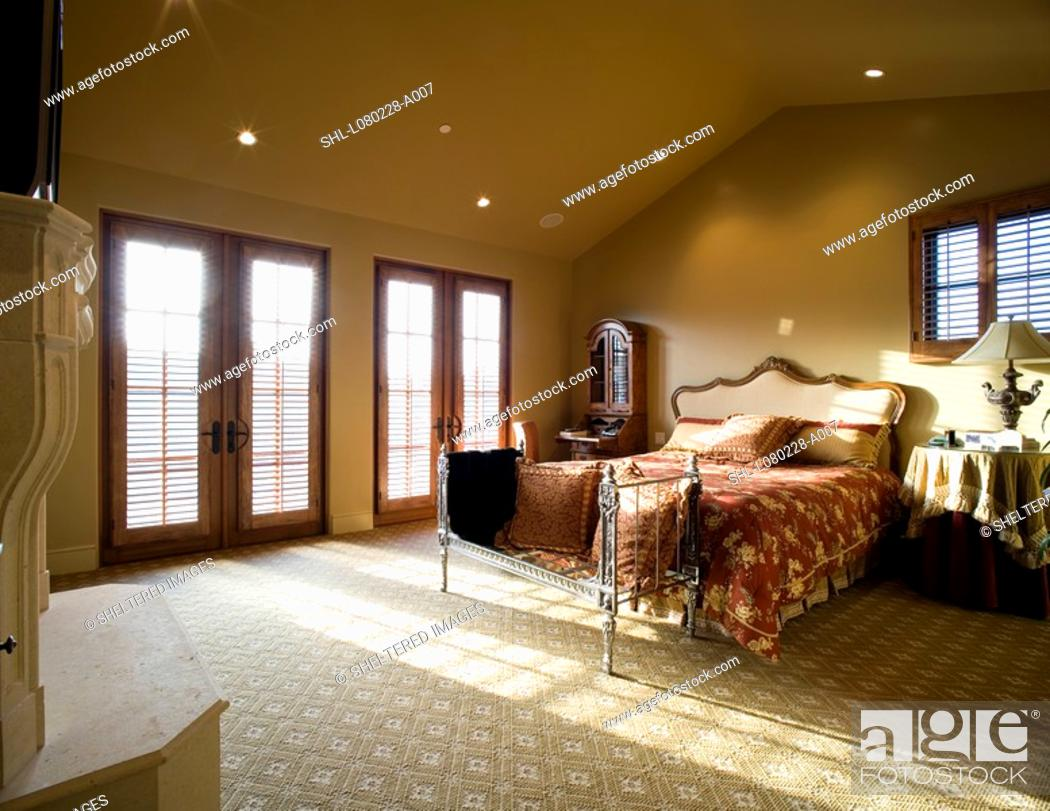Master bedroom with vaulted ceiling and window light ...